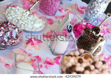stock photo Colorful Wedding Candy Table with all the chocolate goodies on