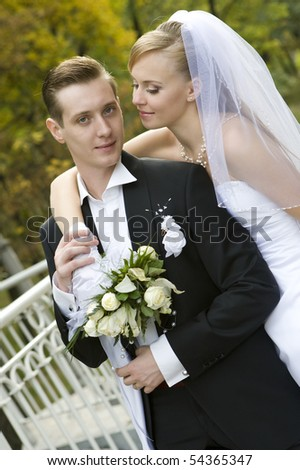 Colorful wedding shot of happy  bride and groom