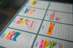 Colorful weekly timetable for scholar classes and freetime with colorful posts and handwritten subjects. White background
