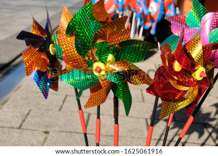 Colorful WindMill Toys shining in front of a shop Stok fotoğraf ©