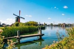 Colorful windmills in Zaanse Schans Netherlands