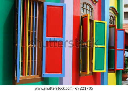 Colorful windows and detail on a colonial house in Singapore.  The picture is full of color.