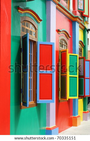 Colorful windows and details on a colonial house in Little India, Singapore.  Full of color, this picture has green, red, blue, yellow and pink.