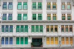 Colorful windows of the building in Singapore. Colorful urban concept. Heritage colorful window frames, Singapore. The building of Ministry of culture, community and youth, Singapore colorful facade