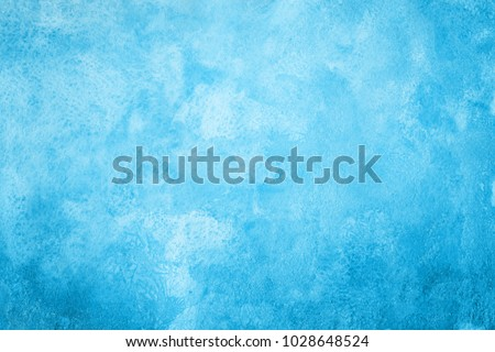 Colorful winter blue ink and watercolor textures on white paper background. Paint leaks and ombre effects.
