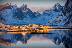 Colorful winter sunrise in the fishing village of Reine, Lofoten archipelago, Norway, above the arctic circle