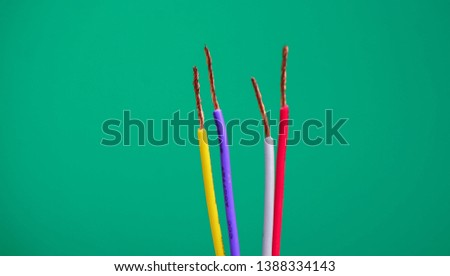 Colorful wire on green background. #1388334143