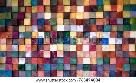 Colorful wood block stack on the wall for background, Abstract colorful wood texture.