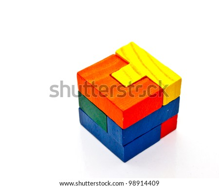 colorful wood puzzles combined to be a cube on white background