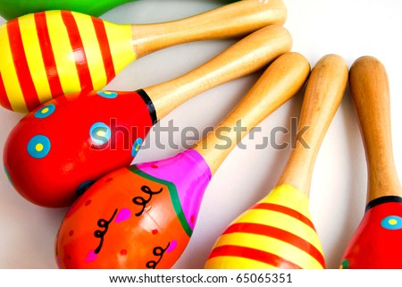 colorful wood toy maracas musical percussion instrument aligned closeup detail as a background picture - stock photo