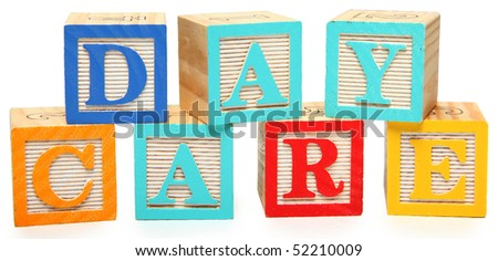 Colorful wooden alphabet blocks spelling the word day care.