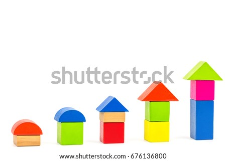 colorful wooden block house show the growth of financial position