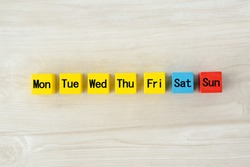 Colorful wooden blocks with omitted day of week words