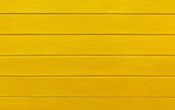 Colorful wooden boards painted in yellow. Yellow wood background.