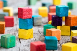 Colorful wooden building blocks. Selective focus