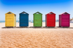 Colorful wooden cabins on the beach of Patacona, Valencia (Spain)