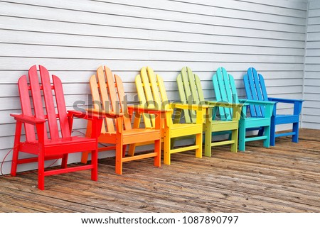 Colorful  wooden chairs on wooden floor