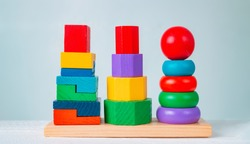 Colorful wooden children's toys on a wooden table