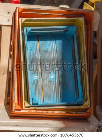 Colorful wooden crate boxes for sale in a market #1076453678