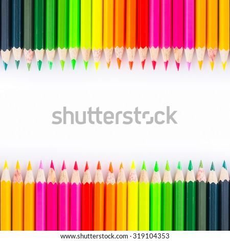 Colorful wooden crayon on white background.