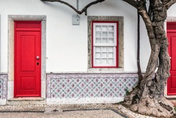 Colorful wooden door in the facade of a typical Portuguese house at Lisbon, Portugal.