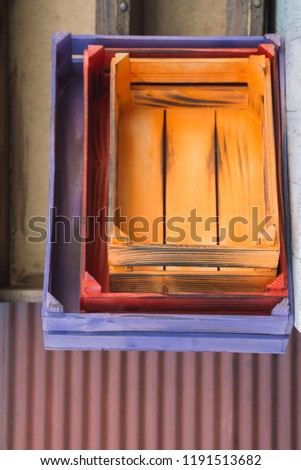 Colorful wooden empty crate boxes for sale in a market place #1191513682