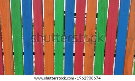 Colorful wooden fence in garden Stok fotoğraf ©