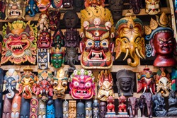 Colorful wooden masks and handicrafts on sale at shop in the Thamel District of Kathmandu, Nepal.