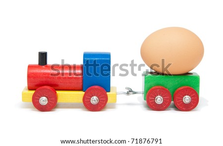 Colorful wooden model railway with an Easter egg on a goods waggon, isolated