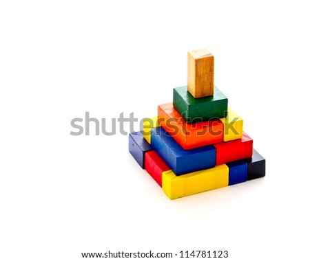 colorful wooden puzzles in pyramid shape on white background