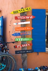 Colorful wooden signposts on Porquerolles