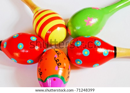 colorful wooden toy maracas music percussion instrument for kid and children play on white background closeup view