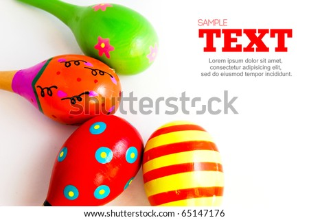 colorful wooden toy maracas music percussion instrument frame with copyspace area isolated on white background