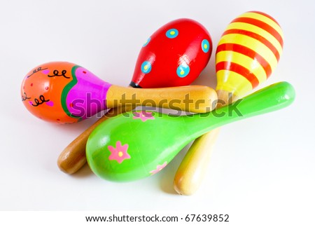 colorful wooden toy maracas music percussion instrument on white background
