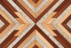 Colorful wooden wall with chevron pattern made of narrow hardwood planks. Wood texture background.