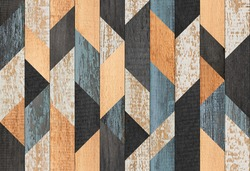 Colorful wooden wall with geometric pattern. Wood texture background. Weathered wooden planks.