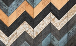 Colorful wooden wall with zigzag pattern. Weathered barn boards texture.