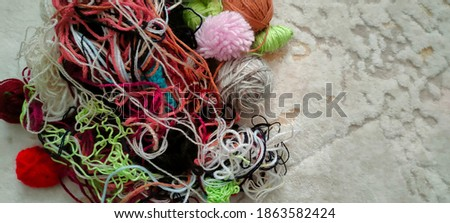 Colorful woolen threads tangled on the floor Stok fotoğraf ©