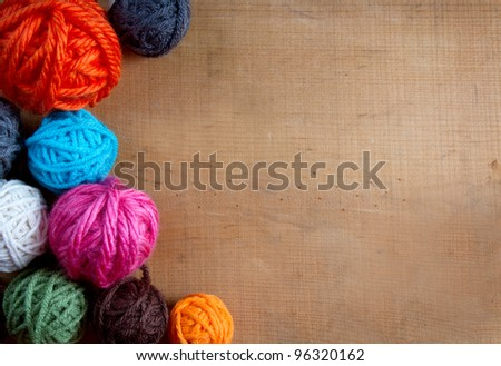 Colorful yarn balls on a wooden background room for copy space