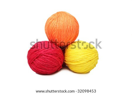 Colorful yarn balls over white background