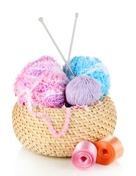 Colorful yarn for knitting in basket isolated on white