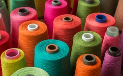 Colorful yarn on spool, yarn on tube, cotton, wool, linen thread