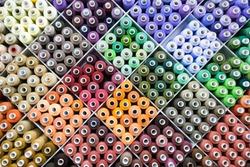Colorful yarn on spool, yarn on tube, cotton, wool, linen thread, polyester
