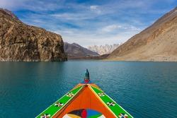 Colorfull boat in Attabad lake in Hunza valley, Karakoram montains range in Pakistan, Asia