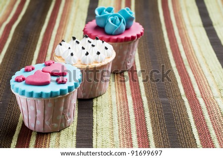 Colorfull cup cake on beautiful mat