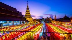 Colorfull Lamp Festival and Lantern in Loi Krathong at Wat Phra That Hariphunchai, Lamphun Province, Thailand.