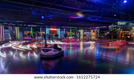 Colorfull long exposure of bumper cars in Vienna during night time with one unmanned cart