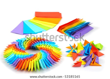 Colorfull origami 3d units like a rainbow circle isolated on white with shadow. From sheets of paper making modules, which joined.
