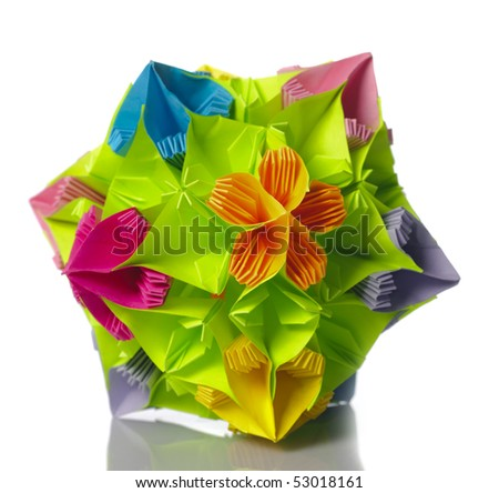Colorfull origami kusudama from rainbow flowers isolated on white.