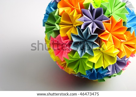 http://image.shutterstock.com/display_pic_with_logo/452452/452452,1265913833,2/stock-photo-colorfull-origami-kusudama-from-rainbow-flowers-isolated-on-white-close-up-with-shadow-46473475.jpg